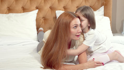 Cute little girl enjoying resting at home with her mother Footage