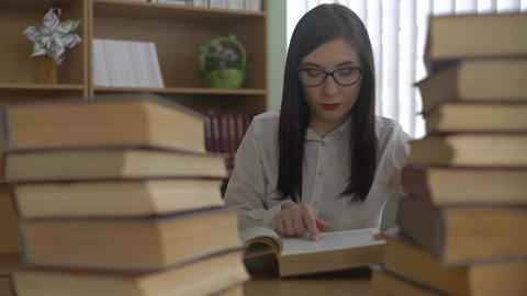 4K Young Woman Studies At The Library Footage