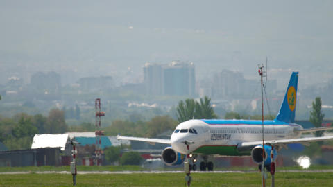 Uzbekistan Airlines Airbus A320 at start position before departure Footage