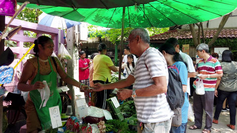 Bangkok, Thailand - 2019-03-17 - Customer Pays For Vegetable Purchase at Market Live Action