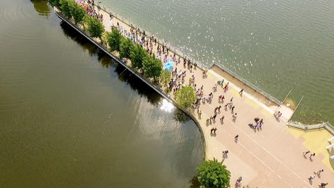 Aerial view of the solemn parade of dance groups marching along the embankment Footage