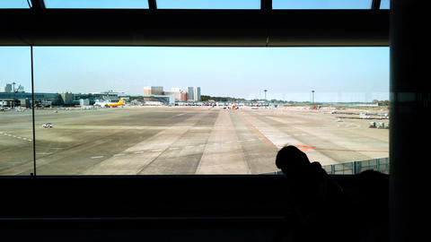 Traveler is walking to the arrival hall in Narita international airport, business travel concept Footage