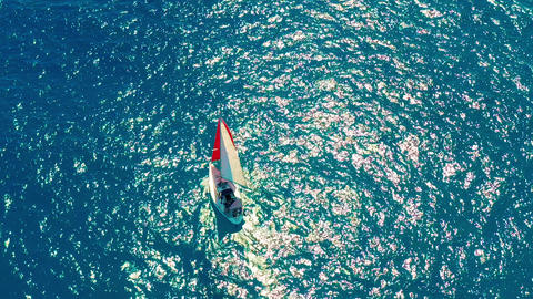 Aerial view. Beautiful sailboat on background blue ocean on a bright sunny day Footage