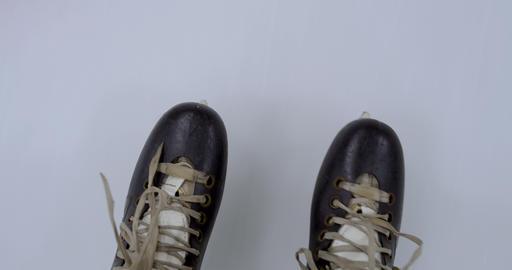 Closeup of hockey skates gliding over ice Footage