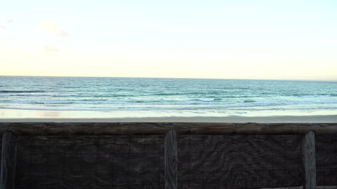 Wooden guard rail before beautiful beach sunrise Stock Video Footage