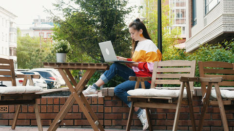 Attractive woman working with laptop outdoor Footage