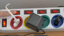 Energy saving. Hand is switching off power on the extension cord Footage