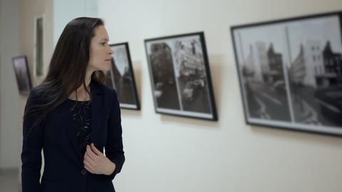 Elegant Beautiful Woman Looks at the Pictures in the Museum of Modern Art. Young Live Action