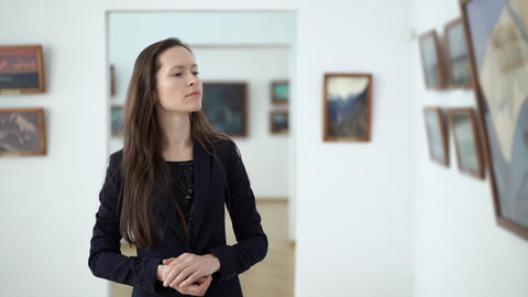 Elegant Beautiful Woman Looks at the Paintings in Gallery During Art Opening Footage