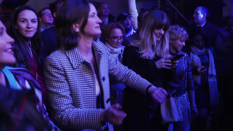 Group of women are enthusiastically dancing in evening at some fun event Footage
