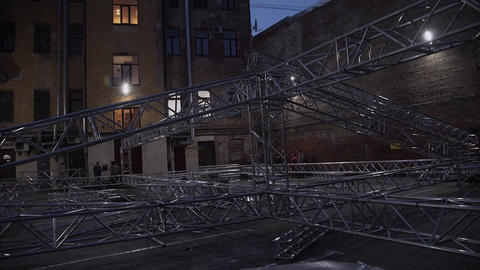 Framework of concert stage aluminium structure placed outside next to old house Footage