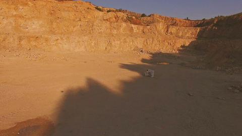 young man plays the piano in the yellow desert on a sunny day. Surrealism Footage