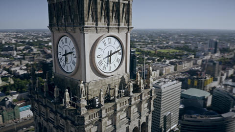 Aerial view of the clock with city coat of arms on historic Palace of Culture Live Action