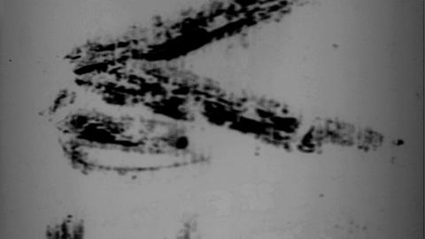 Flicker 003: A punch-hole and writing on scratched film leader Footage