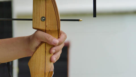 Archer holds his bow aiming at a target Footage