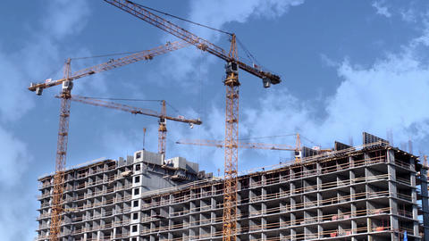 construction skyscraper tower cranes in the clouds time lapse Footage