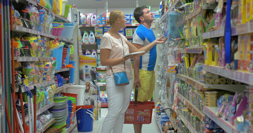 Family couple shopping for household goods in supermarket Footage