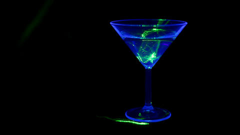 Cocktail lit with UV light and green laser Footage