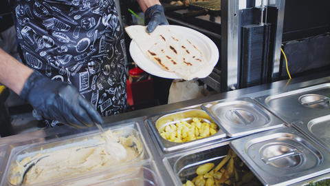 chef grills pita and assembles tasty dish in cafe closeup Footage