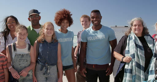 Volunteers standing together on beach in the sunshine 4k Live Action