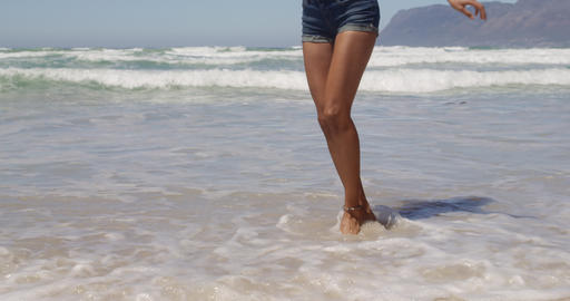Woman dancing on beach in the sunshine 4k Live Action
