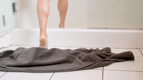 Attractive woman drops her towel as she enters the shower Footage
