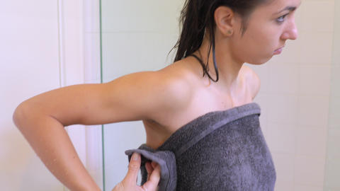 Attractive woman drying off aster taking her morning shower Footage