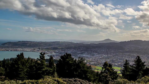 New Zealand View of Heights. Sunshine. In the blue sky, white, thick clouds Live Action