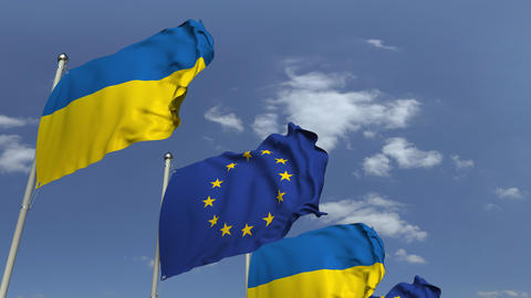 Flags of Ukraine and the European Union at international meeting, loopable 3D Footage