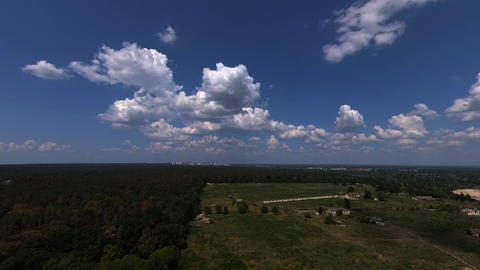 Clouds timelapse over the rural area Live Action
