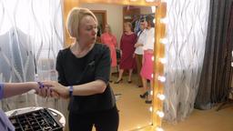 Elegant woman choosing bracelet in jewelry store together friends. Style expert Footage