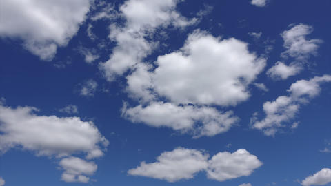 Timelapse shot of beautiful clouds in the atmosphere. Blue heaven with white Live Action