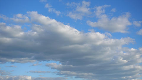Beautiful Cumulus clouds move fast across the blue sky, Timelapse. Beauty of Footage
