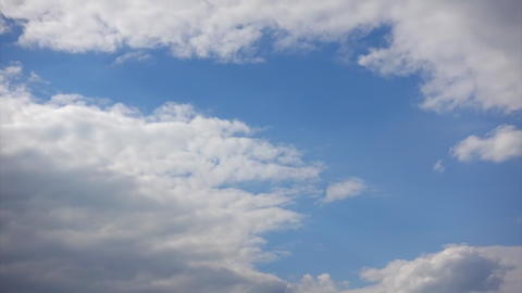 Clouds cover the blue sky, Timelapse. Air flows in the atmosphere Live Action