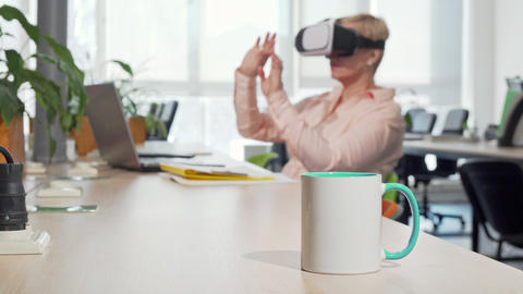 Female entrepreneur using 3d virtual reality goggles at the office Footage