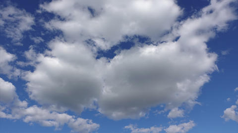White fluffy clouds in the blue sky, Timelapse. Clean atmosphere and Live Action