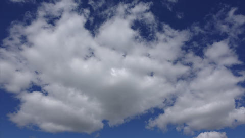 Timelapse shot of clouds. White clouds high in the blue sky, nature colors Footage