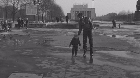 SAINT PETERSBURG, RUSSIA, 1985: Old vintage black and white film man walking Live Action