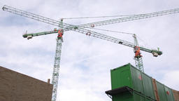 Tower Cranes and Cloudy Sky Low Angle Footage