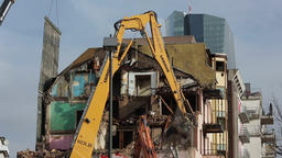 High Reach Demolition Excavator Breaking Down Old Apartment Building Live Action