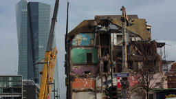 High Reach Demolition Excavator Working on Old Apartment Building Live Action