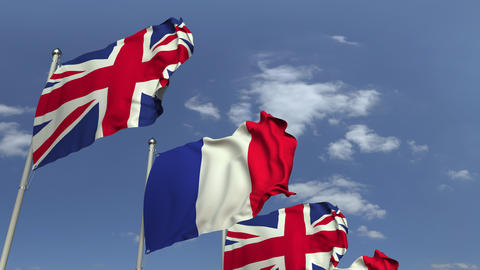 Waving flags of Great Britain and France on sky background, loopable 3D Live Action