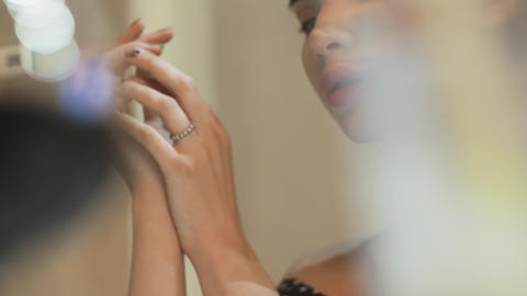 view to the thin hands, palms and fingers of young sophisticated woman thru the Footage