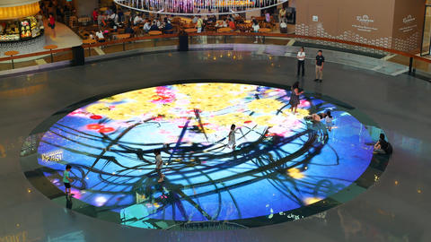 Children play on Digital Light Canvas inside The Shoppes in Singapore Live Action