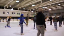 People ice skating. Ice skating rink. Defocused Live Action