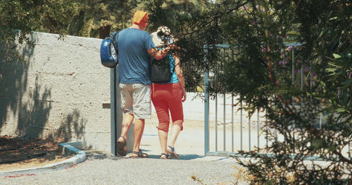 Couple with Backpacks Going for Walk Footage
