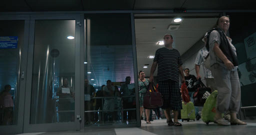 People Coming Out Sliding Doors of Arrivals Hall Footage