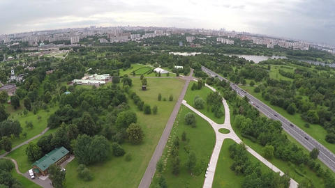 Flying over the city with vast green plantations Footage