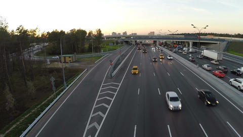 Flying over the city highway in the evening Footage