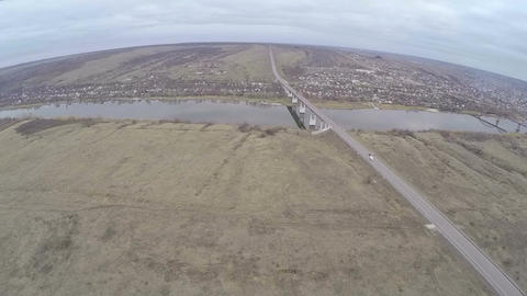 Aerial shot of cars driving on bridge over the river Footage